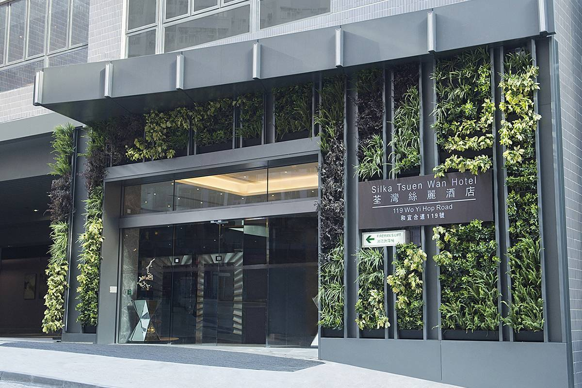 Main Entrance: A green wall is planted with different types of plants