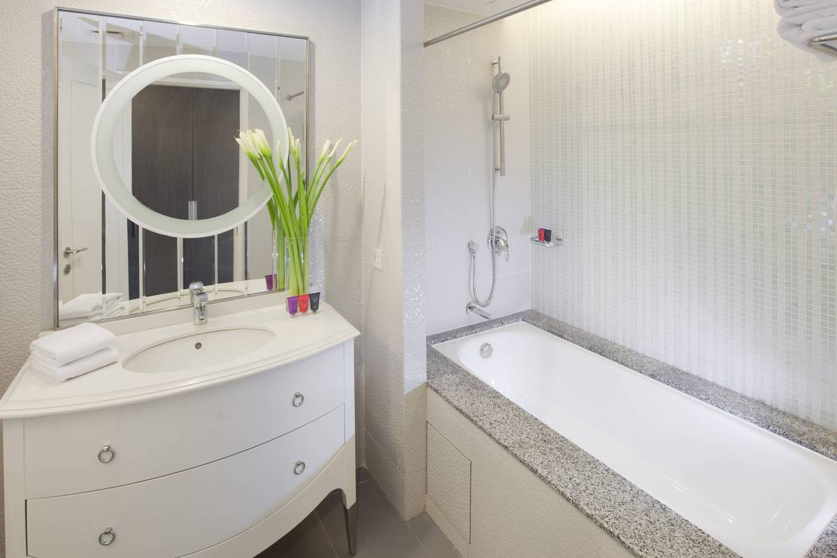 Deluxe Room Bathroom: Bathtubs are in some rooms to enjoy a relaxing soak