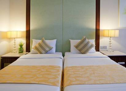 Standard Room: Twin bed arrangement for a comfortable and restful night's sleep